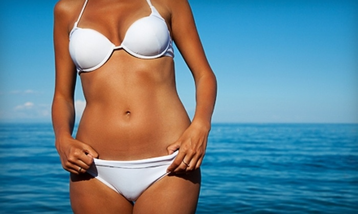 Bodyheat Tanning - Multiple Locations: $30 for Two Spray Tans or Two Any-Level Tanning-Bed Sessions, Plus One Month of Unlimited Red-Light Therapy at Bodyheat Tanning (Up to $130 Value)