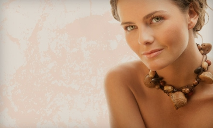 Tropical Tans of Arlington - Arlington: $19 for One Month of Unlimited Tanning or Two Airbrush Tans at Tropical Tans of Arlington (Up to $61.90 Value)