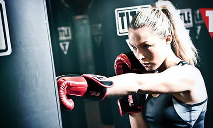 Title Boxing Club - Edina: Two Weeks or One Month of Boxing and Kickboxing Classes with Hand Wraps and Gloves at Title Boxing Club (Up to 62% Off)