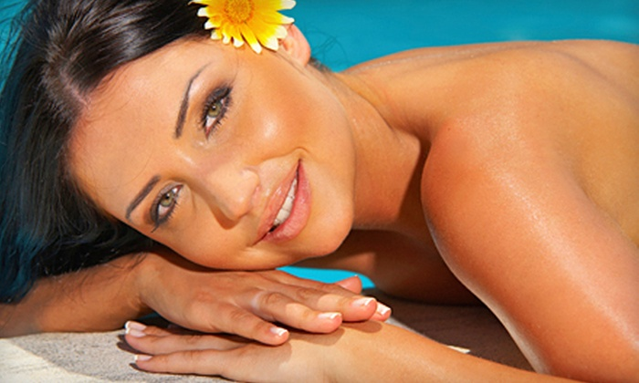 Family Tans, Inc. - Southeast Warren: One or Three Spray Tans, or Five Level 1 UV Tans at Family Tans, Inc. (Up to 61% Off)
