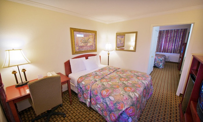 Orchid Suites - Lead Hill: $105 for a Two-Night Stay for Two with Bottle of Wine and a Breakfast in Bed at Orchid Suites