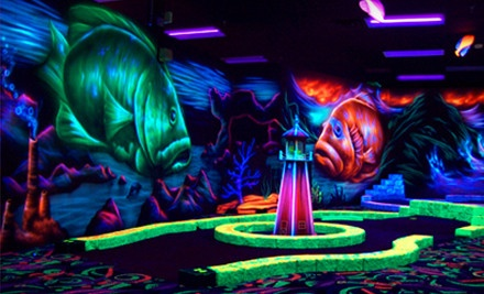 Black-Light Mini Golf and Black-Light Mini Bowling for Up to Four or Eight at Oceans 18 (Up to 48% Off)