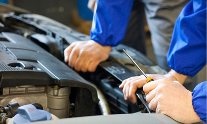Beckett's Automotive Center - Northwest Columbia: Regular or Synthetic Oil-Change Package with Tire Rotation, Battery-Corrosion Package, and Inspection (Up to 68% Off)