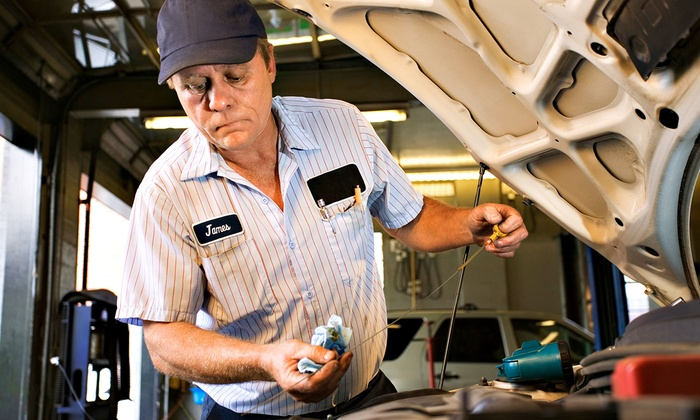 Auto Tech Plaza - Multiple Locations: Oil Change with Brake Check and Tire Rotation or an Air-Conditioner Tune-Up at Auto Tech Plaza (Up to 57% Off)