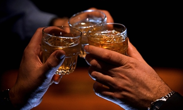 The Penguin Dueling Piano Bar - West Suburb: $15 for $30 Worth of Libations and Live Music at The Penguin Dueling Piano Bar