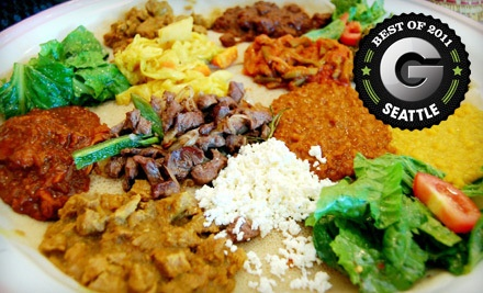 1 Appetizer, a Habesha Combo for 2, and 2 Desserts (a $50 value) - Habesha in Seattle