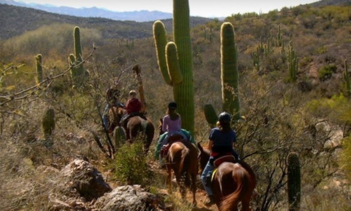 Bandit Outfitters - Vail: $22 for a Ninety-Minute Sunrise or Sunset Trail Ride at Bandit Outfitters' Colossal Cave Mountain Park Riding Stables in Vail ($42 Value)