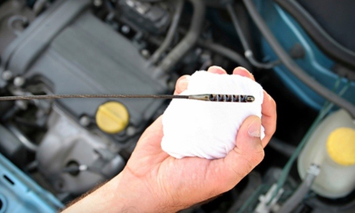 Express Oil Change & Service Center - Big Creek: $25 for Oil Change, Tire Rotation, Brake Inspection, and Inspection at Express Oil Change & Service Center in Cumming ($58.98 Value)