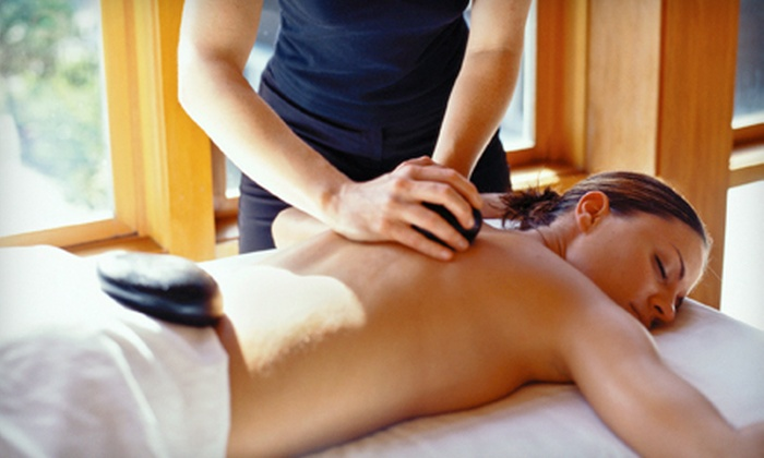 Haile Village Spa and Salon - Gainesville: $75 for a Body Wrap, Sports Massage, Warm-Stone Therapy, and Foot Scrub at Haile Village Spa and Salon ($155 Value)