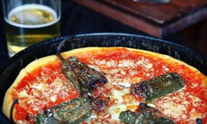 Gino's East Sports Bar - South Loop: 9- or 12-Inch Deep-Dish Pizza with Wine or Craft Beer for Two or Four at Gino's East Sports Bar (Up to 55% Off)