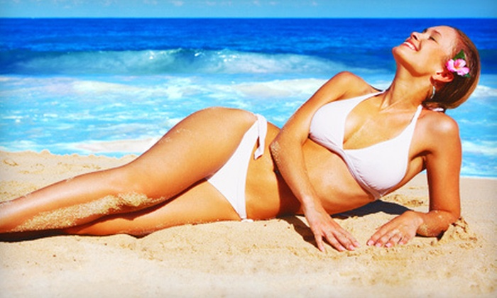 Golden Tan Salons - Multiple Locations: 5 Mystic Spray Tans or Up to 20 UV-Tanning Sessions at Golden Tan Salons (Up to 61% Off)