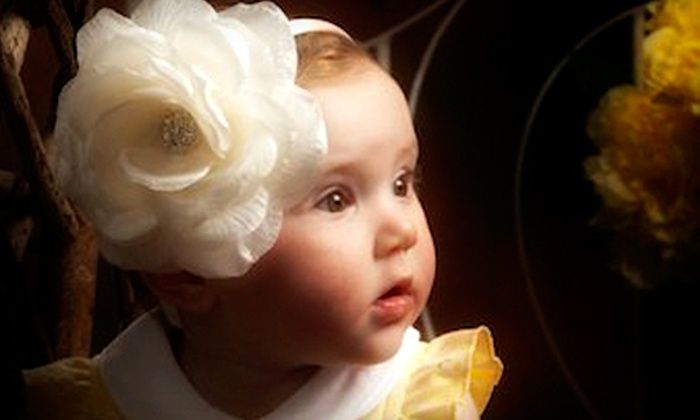 Creative Photo - Columbia: $50 for Portrait Package with One-Hour Shoot and $100 Credit for Prints at Creative Photo ($175 Total Value)