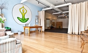 Two Weeks Or A Month Of Unlimited Yoga Classes Or 10 Yoga Classes At Charleston Community Yoga (up To 61% Off)