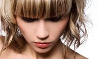 GROUPON: Up to 51% Off Haircut and Highlights Santana Salon & Spa