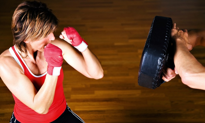 Tiger Schulmann's Kickboxing & MMA - Multiple Locations: $49 for One Month of Unlimited Adult Kickboxing Classes and Apparel at Tiger Schulmann's Kickboxing & MMA ($239 Value)