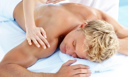 image for Swedish Massage, Men's Haircut, or Both at Knockouts Haircuts for Men (Up to 48% Off). Four Options.