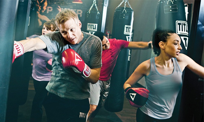 TITLE Boxing Club - Multiple Locations: $19 for Two Weeks of Unlimited Boxing and Kickboxing Classes with Wraps at TITLE Boxing Club ($55 Value)