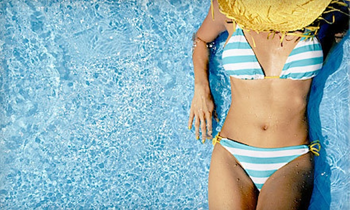 Electric Beach - Eastchester: One Month of Unlimited UV Tanning, or One or Three Custom Airbrush Spray Tans at Electric Beach (Up to 85% Off)