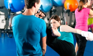 PTC Combat Fitness: $28 for One Month of Unlimited Kickboxing Classes at PTC Combat Fitness ($80 Value)