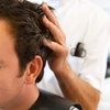 57% Off a Haircut with Shampoo and Style