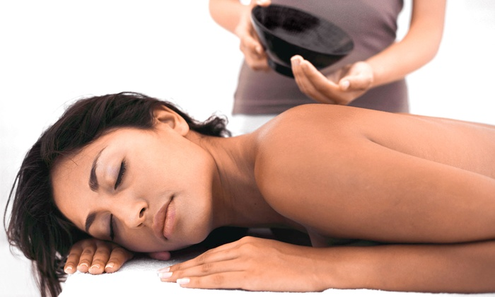 Pure Wellness Co. - Clermont: 60- or 90-Minute Massage with Hot Towels and Aromatherapy or a Deep-Heat Treatment at Pure Wellness Co. (Up to 54% Off)