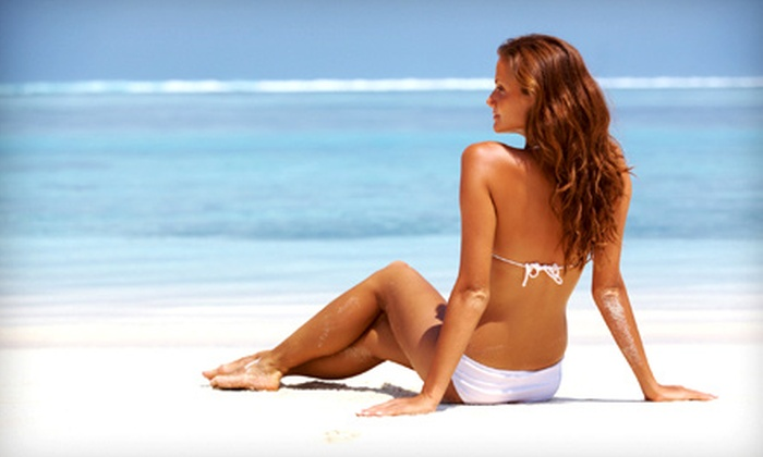 Downtown Tan - Kelowna: Spray Tanning, Teeth Whitening, and UV Tanning at Downtown Tan (Up to 73% Off). Five Options Available.