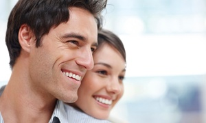 1st Family Dental: Zoom! Whitening or Dental Exam Packages at 1st Family Dental (Up to 84% Off)
