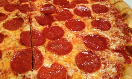 Family Pizza Meal with Garlic Knots and Soda at Johnny's Pizza (Up to 49% Off)