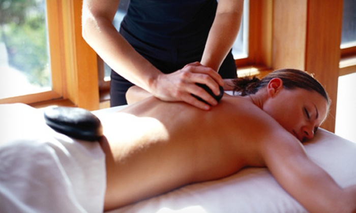 Evolve Salon & Day Spa - Evolve Salon & Day Spa: One or Three Swedish Massages or One Hot-Stone or Aromatherapy Massage at Evolve Salon & Day Spa (Up to 53% Off)
