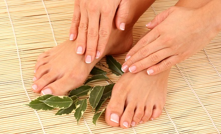 One or Two Mani-Pedis, UV Gel Nails, or Acrylics at Aqua Salon and Day Spa (Up to 57% Off)