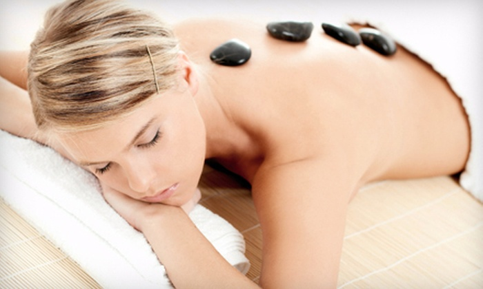 Solutions Modern Massage - Englewood: 75-Minute Massage Package with Hot Stones or Two 60-Minute Massages at Solutions Modern Massage (Up to 69% Off)