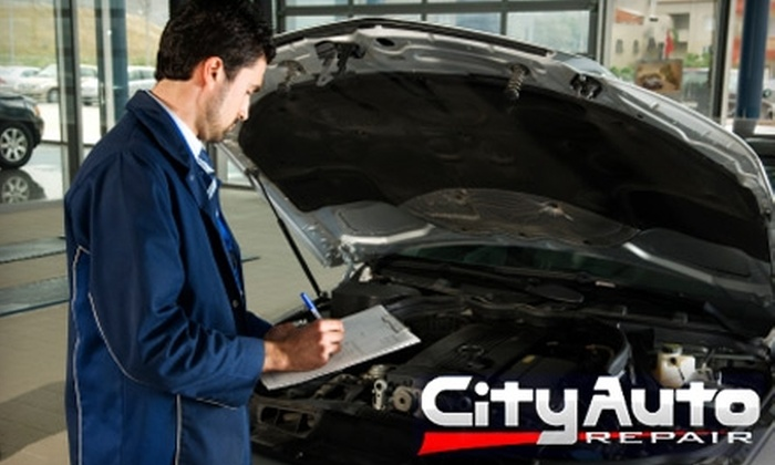 City Auto Repair - Gainesville: Oil Change and Tire Rotation from City Auto Repair. Choose Between Two Options.