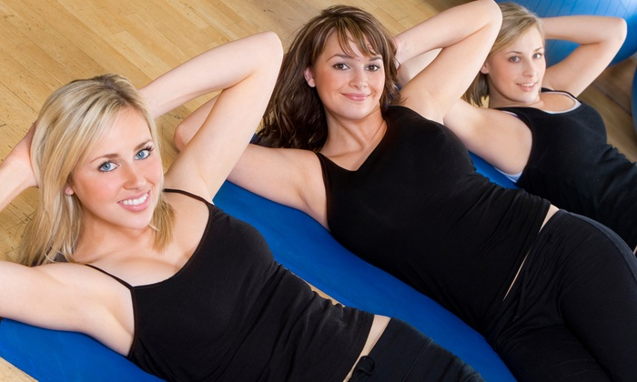 Pure Heat Yoga - Genoa: $30 for Any Five Classes at Pure Heat Yoga and Fitness ($75 Value)