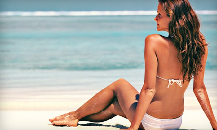 Tan Shadows - Multiple Locations: One, Three, or Five VersaSpa Spray Tans or Month of Unlimited Bed Tanning at Tan Shadows (Up to 63% Off)
