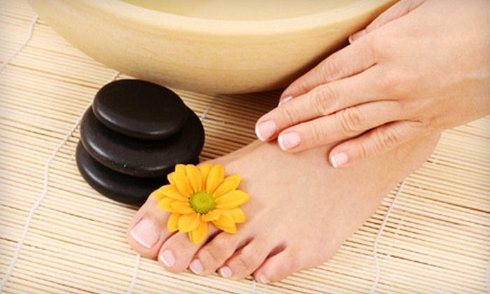 Refined Skin Medi-Spa - Red Wing: $49 for a Hot Stone Foot Treatment and a Signature Scalp Treatment at Refined Skin Medi-Spa in Red Wing ($110 Value)