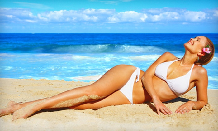Hollywood Tans - Multiple Locations: Five UV Tans or Three Mystic Spray Tans at Hollywood Tans