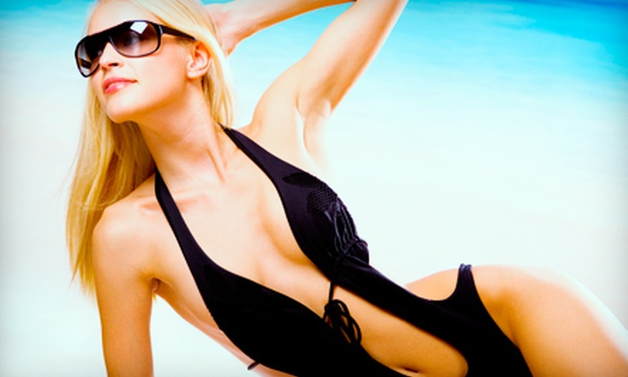 Tropical Tans - Multiple Locations: Two Spray Tans or 30 Days of Unlimited Level Three Tanning at Tropical Tans