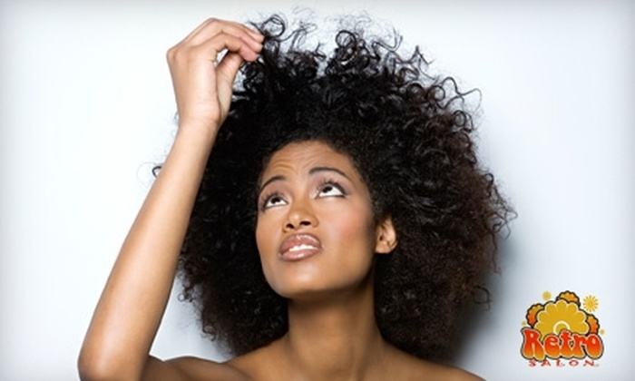 Retro Salon - Appleton: $12 for a Shampoo, Cut, and Style (Up to $25 Value) or $12 for a Facial Wax and Two Tanning Sessions with Lotion (Up to $25 Value) at Retro Salon