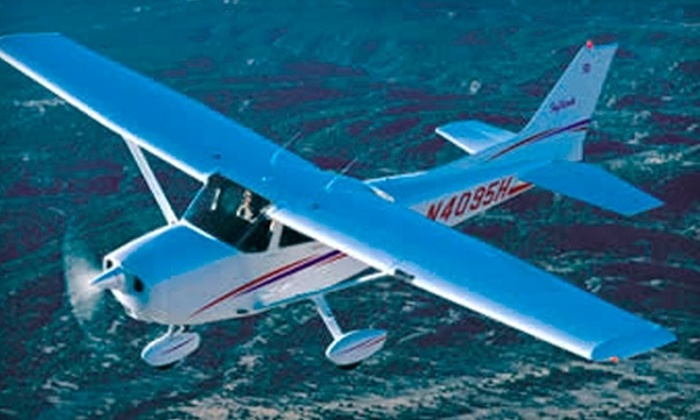 Don Davis Aviation - Corydon: $80 for One-Hour Airplane Ride for Up to Three People from Don Davis Aviation ($163 Value)