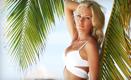 One Full-Body Spray Tan (a $40 value) - Velvet Wax Spa in Orlando