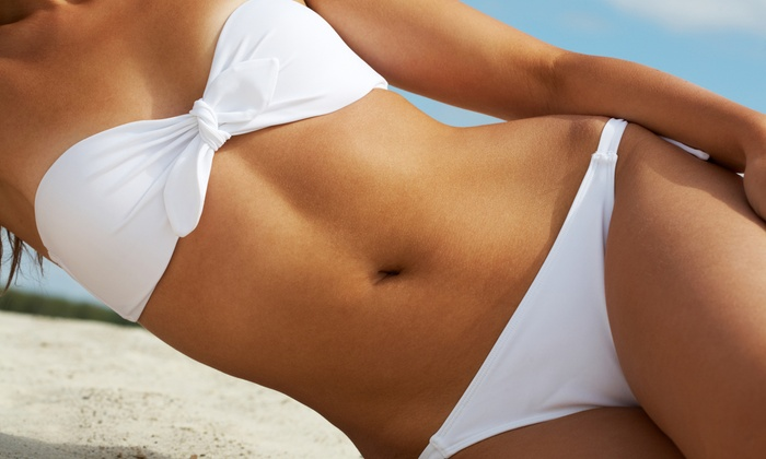 Tropi Tan - Multiple Locations: Three, Five, or Eight VersaSpa Spray Tans at Tropi Tan (Up to 65% Off)