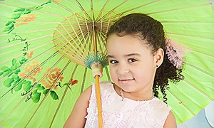 Punky Doodle Bugs Photography: Photo-Shoot Package for Up to Four People with Prints or Digital Images at Punky Doodle Bugs Photography (Up to 61% Off)