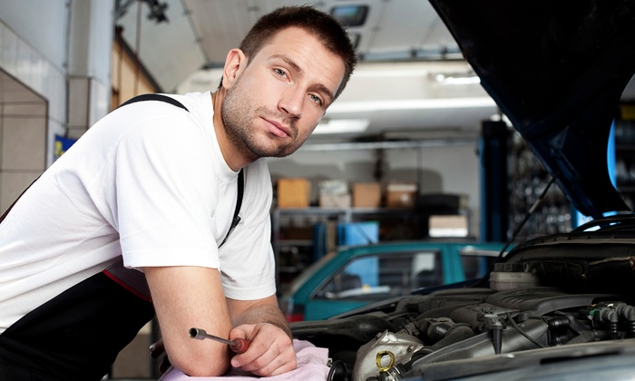 Express Oil Change & Service Center - Hurst: Oil Change, Texas State Auto Inspection, or Both at Express Oil Change & Service Center (52% Off)