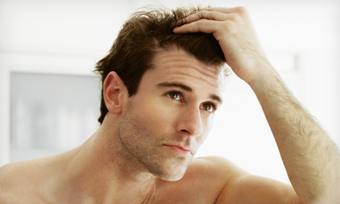 Evolve Hair Clinic - Eagan: $99 for 12 Laser Hair-Restoration Therapy Sessions at Evolve Hair Clinic ($225 Value)
