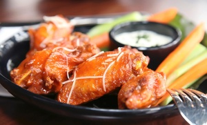 Pizza Bolis: One Order of Wings with Purchase of 2 Large 1 Topping Pizzas at Pizza Bolis