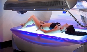 Electric Sun Tanning Salons: One Week of Bed Tanning or Two Spray Tans at Electric Sun Tanning Salons (87% Off)