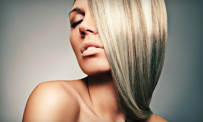 Platinum Hair Design - Rolando: $22 for a Designer Haircut at Platinum Hair Design ($60 Value)