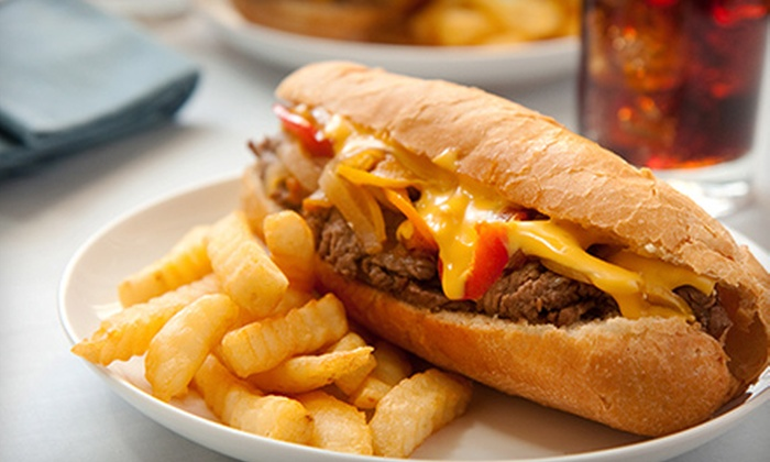 McGonagle's - National City: Philly Cheesesteaks, Fries, and Sodas for Two or Four at McGonagle's (Half Off)
