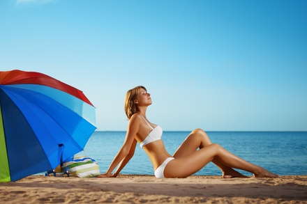 A Custom Airbrush Tanning Session at Sweet Skin (48% Off)