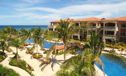 Stay at Infinity Bay Spa & Beach Resort in Roatan, Honduras; Dates into December